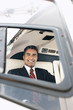 businessman sitting in helicopter portrait