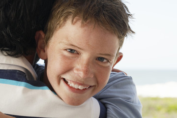 father and son hugging portrait of son head and shoulders