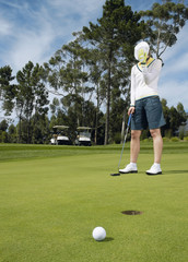 disappointed golfer on putting green