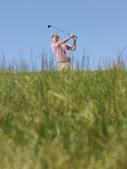 male golfer driving ball