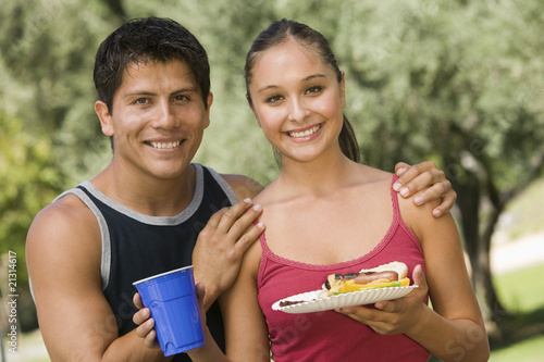 young couple at picnic front view.
