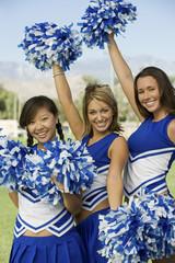 cheerleaders waving pom-poms (portrait)