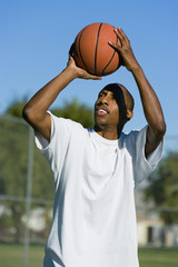 man aiming to shoot basketball
