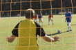 goalkeeper defending back view