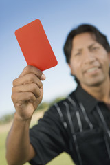 referee holding up red card portrait
