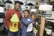 couple choosing birdhouse in shop