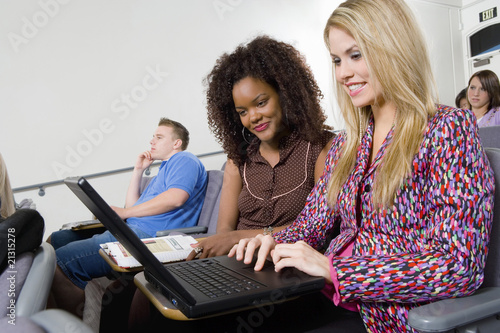 students using laptop in classroom