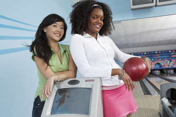 young women at bowling alley portrait
