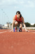 female athlete on starting block