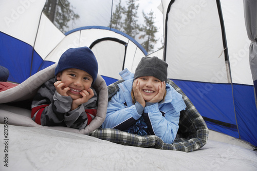 brother and sister (7-12) in tent (portrait)