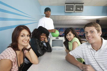 Group of Friends in Bowling Alley