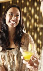 smiling woman at bar socializing