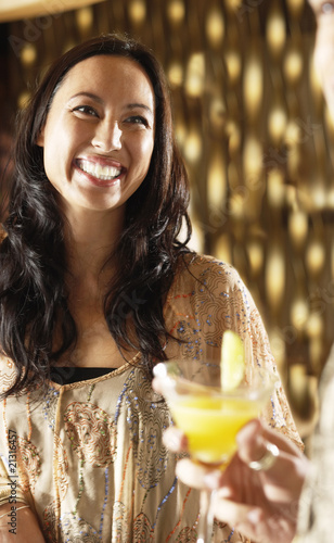 smiling woman at bar socializing