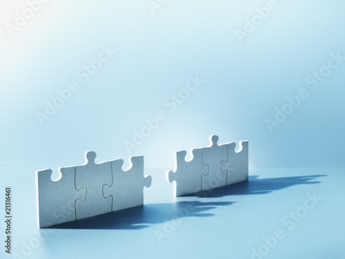 Jigsaw puzzle pieces standing on end