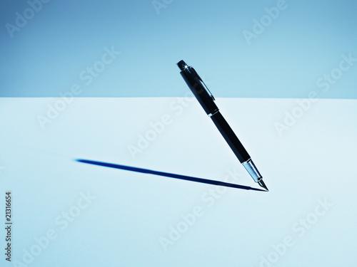 Fountain pen casting shadow