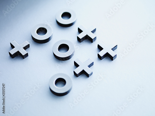 Metal tic-tac-toe game pieces