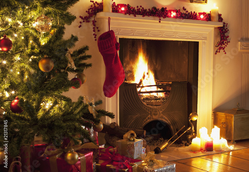 Christmas tree and stocking near fireplace