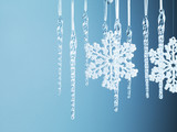 Snowflake and icicle Christmas ornaments hanging from string