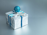 Christmas gift with silver wrapping and blue ribbon