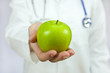 Doctor Holding Green Apple