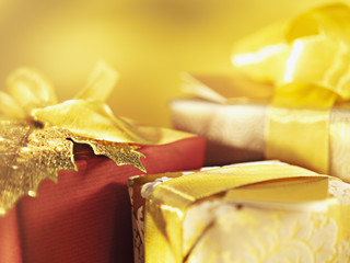 Christmas gifts with gold ribbon