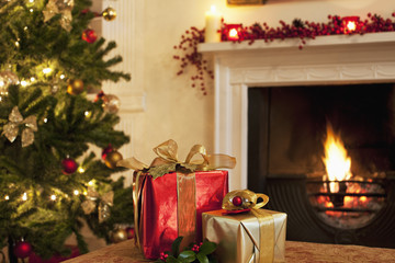 Christmas gifts near tree and fireplace