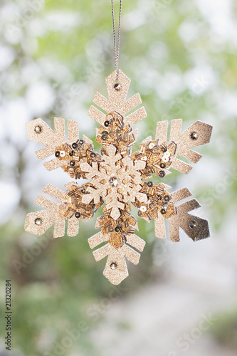 Close up of snowflake Christmas ornament hanging on string