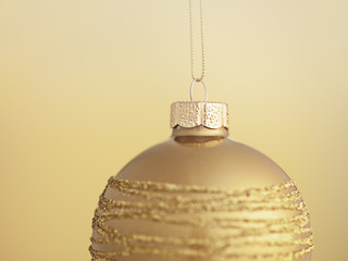 Close up of Christmas ornament hanging on string
