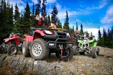 Group of quadbikes parked on top of a mountain
