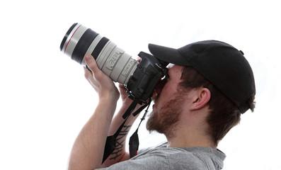 Mann Fotograf mit Kamera Teleobjektiv Himmel beobachten