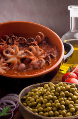 bowl with octopus and tomato sauce