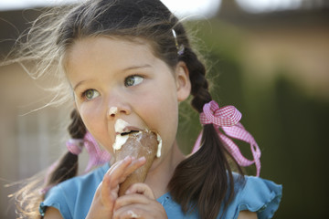 Girl eating messy ice cream cone