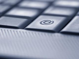 Close up of the at symbol key on computer keyboard