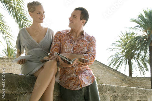 Man and woman reading guidebook