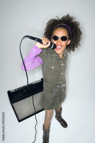 Girl with sunglasses singing