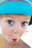 little boy with blue eyes surprise