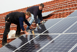 installing solar modules on a roof 06