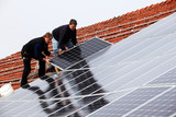 installing solar modules on a roof 07