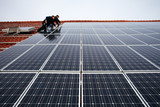 installing solar modules on a roof 10 poster