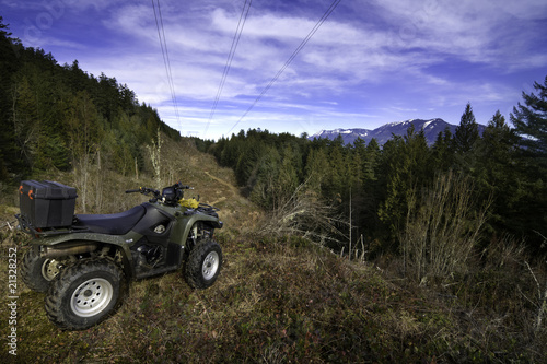 Quadbike parked on mountain ridge