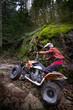 Teen riding ATV in mountains