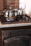 Metal cooking pan on gas burner with burning gas flames poster
