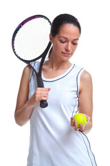Woman tennis player holding a ball and racket