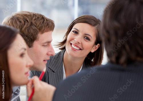 Portrait of an assertive businesswoman and her team