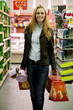 young woman at the supermarket buying pandoro and panettone