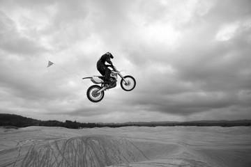 Dirt bike jumping sand dunes - High up