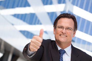 Handsome, Confident Businessman with Thumbs Up