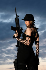 Sexy woman with assault rifle