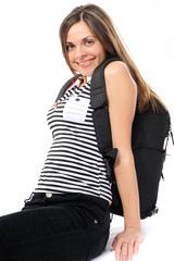 Pretty young woman with a backpack, smiles
