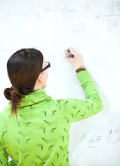 young female college student in front of a whiteboard during a m